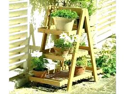 quadrant plant stand with four planters crate and barrel garden indoor stands p