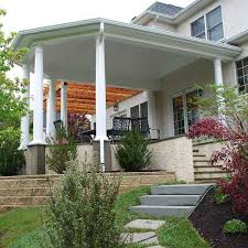 step up to outdoor living luxury and elegance in this covered archadeck porch