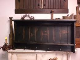 huge primitive black wooden peg shelf