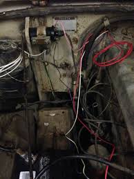 where does the red solenoid power wire connect to using ez as much as it looks like it that black wire the blue connector on it is not ground to the firewall ez told me to seal that wire and leave it
