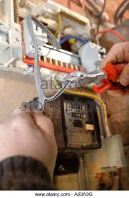 old switch boxes stock photos old switch boxes stock images alamy an electrician removes old electricity fuse boxes and installs a memera consumer unit uk stock