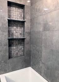designs shower niche with three shelves built in above bathtub