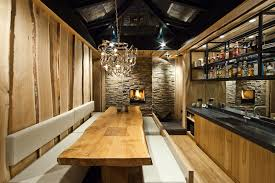 rustic dining room with artistic brushed nickel pendant lamp