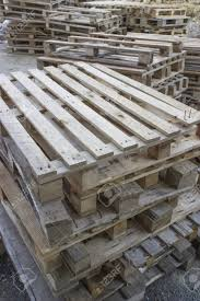 stock photo used wood pallet at construction site stacked up ready for reuse used pallets o99 wood