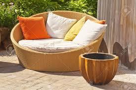 a modern wicker garden sofa or love seat in the home garden stock