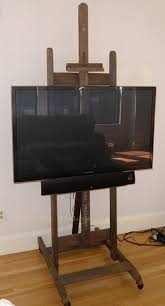 flat screen tv stand formerly known as an artists easel the tv stand easel