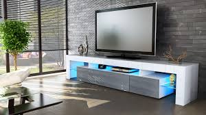 grey high gloss wall tiles. high gloss tv stand unit with led lights dark grey stone wall tile black window blinds white tufted chair chrome base glass side table huge tiles