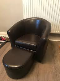 free childs brown faux leather tub chair and footrestin moortown west yorkshire anyone want