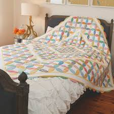 Mixed Peel Quilt By Frances Leate & Styled shot of appliqué orange peel quilt on bed Adamdwight.com