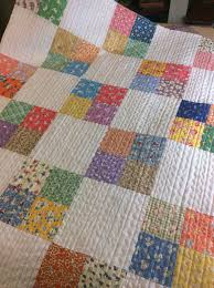 A pretty quilt made for charity. Love the quilt stitching! | Mama ... & Charm squares quilt / straight line quilting Adamdwight.com