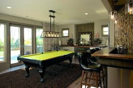 pool table chandelier living room with pool table family room transitional with window wall brown rug built pool table chandelier height