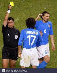 Italy's Cristiano Zanetti (R) is restrained by teammate Damiano Tommasi (C)  after receiving a yellow card from referee Byron Moreno during a second  round World Cup Finals match against South Korea in