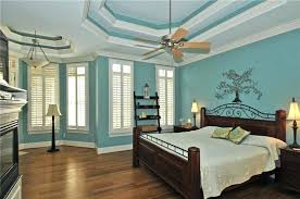 Teal And White Bedroom Traditional Bedroom With Teal Painted Walls Wood  Flooring And White Molding Teal
