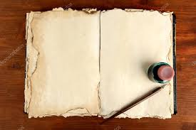 open old book ink and ink pen on wooden background stock photo