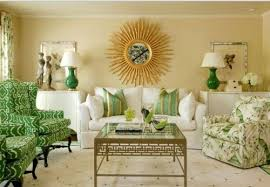Crisp white and apple green make for a lively dcor in another traditional  living room. I love the deep green on the chunky lamps.