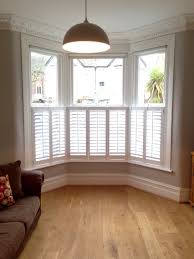 Living Room Victorian House Cafe Style Shutters On A Victorian Bay All Closed For The Home