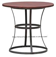 modern industrial round metal dining restaurant vintage wooden table