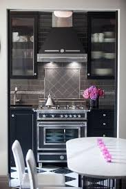 gray backsplash dark cabinets. This Striking Design Is Gorgeous Combination Of Shades And Textures Keeping To The Theme Throughout Gray Backsplash Dark Cabinets