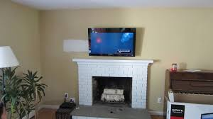 simple mounting tv over fireplace by mounting tv over fireplace gas fireplace with tv above this