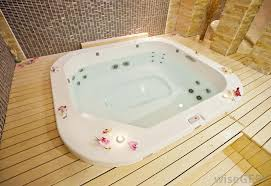 A water-filled hot tub, also known as a Jacuzzi.