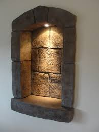 wall niche lighting. Interesting Wall Natural Stones Wall Niche With Small Spot Light Fixture On Top Throughout Wall Niche Lighting