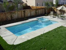 Appealing Blue Water Rectangular Pool Designs With Wooden Fences Around  Also Green Grass Backyard Garden Inspirations Tips