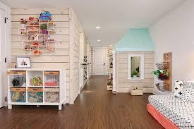 wooden floors and wood wall paneling basement for kids basement playroom dark hardwood flooring floors floating