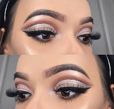 meanwhile black winged eyeliner and lashings of mascara help to plete the glamorous makeup look add soft peach blush and taupe lips to truly wrap up