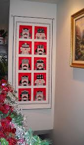 Amy Bradley Designs: Nutcracker & Josephine just shared this photo with me today. She made her own version of  the nutcracker quilt to fit her wall above her stairs. Adamdwight.com