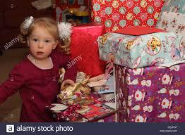 2-year-old girl opening Christmas presents Stock Photo: 43438759 - Alamy