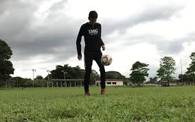a soccer player training by yourself