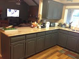 kitchen cabinet design ideas with two colour combination of dark gray cabinets and creamy countertop and wall paint