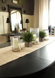 Top 9 Dining Room Centerpiece Ideas I like the dark brown wall color on  top. The cream curtains and runner on the table compliment it nicely