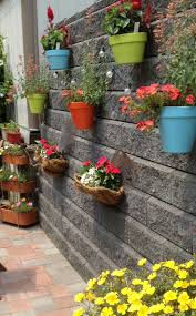 deafdedaefabafdb painted clay pots hanging gardens luxury wall flower planters