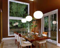 dining room light fixture in elegant themed dining room with big white pendant lamp made of glass hanging on