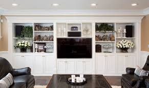 large white tv wall unit with shelving and crown