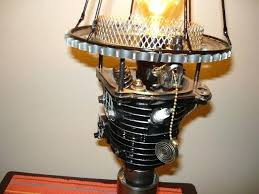 close look at table lamp made from used car motorcycle scooter and bicycle parts hand forged