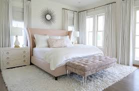 blush pink wingback bed with lucite