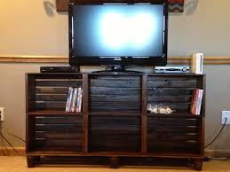 tv stand made from crates matches the coffee table