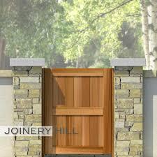 cedar wooden garden gates stone column stucco garden wall entrance