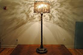 An Italian Baroque Style Cast Brass Floor Lamp with Woven French Lampshade 2