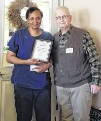 retha burns a caregiver at bell gardens place recently received a recognition award for
