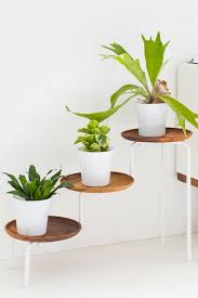 Staggered Plant Stand: The IKEA PS plant stand is cool, but if you agree  that the white stands are a little meh, try swapping them out with wooden  trays ...