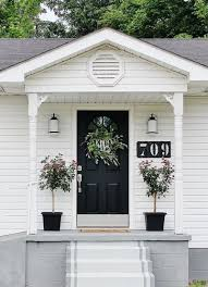white porch stained concrete black door our fixer upper