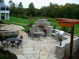 georgeous fireplace facing simple sitting area on paving pathway for backyard patio ideas