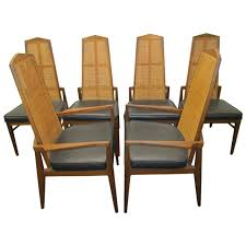 six walnut foster and mcdavid cane back dining chairs midcentury