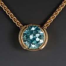 18ky slide pendant w 1 47 carat blue zircon cambodia