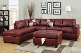 living room with bonded leather sofa and ottoman