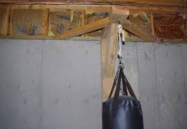 p hanging 70 lb heavybag punching bag from ceiling joists in basement