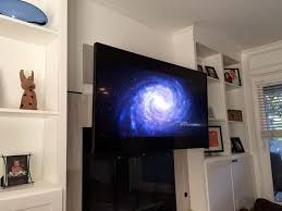 mantelmount is the premier pull down over the fireplace tv mount your tv glare and neck strain days are over